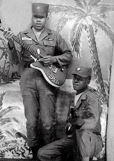 Jimi Hendrix in the Army holding a Danelectro Bronze Standard