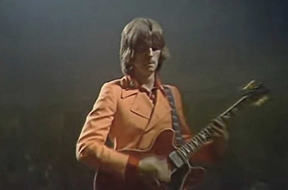 Eric Clapton playing a red Gibson ES-335